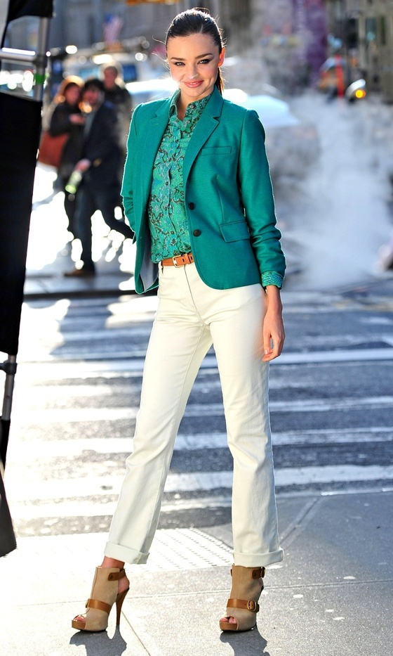 teal jacket, teal blouse with white pants