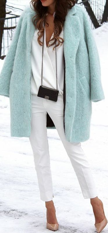turquoise coat with white pants